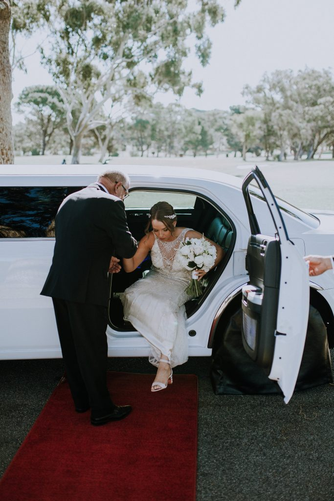 Rear opening door of limousine making exit easy for bride